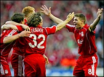 Kuyt, Stevie G and others are celebrating the winning penalty